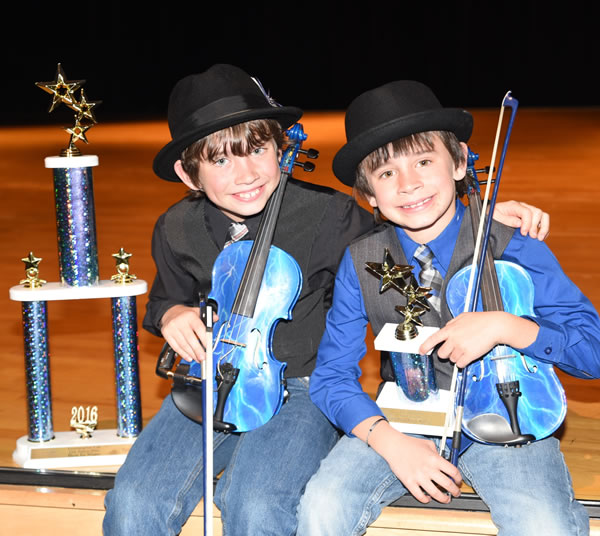 "Alex and Sean with trophies at ""Learning for Life"" talent competition. Alex won ""Best in Show"" & Sean won 3rd place"